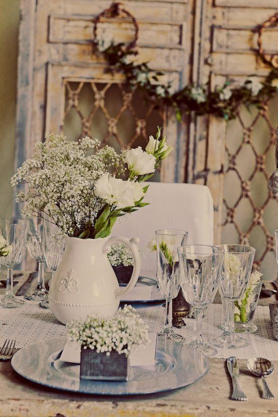 Love the white ceramic vase with white florals!