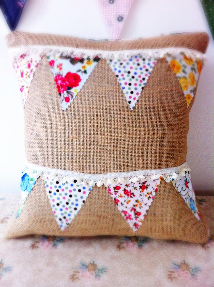 Bunting cushion on hessian background with colourful