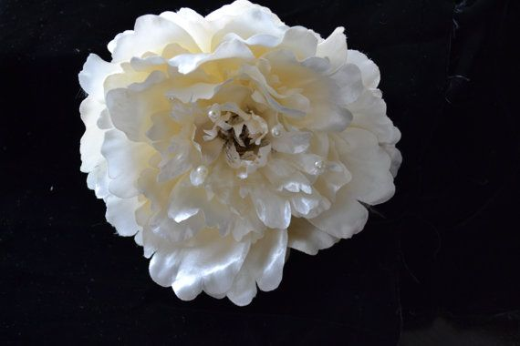 Large cream coloured peony accented with pearls.