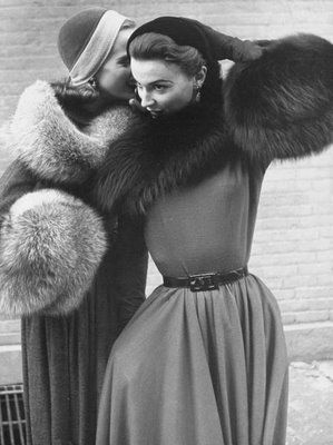 Ladies Modeling Tie on Collars and Matching Barrel Muffs Made of Natural Fox…