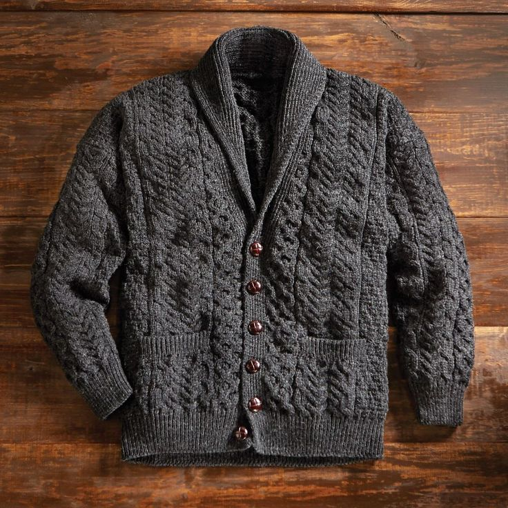 "In just a century since they first appeared, the textured wool sweaters of the Aran Islands have become ""as tenacious an international symbol of Ireland as the harp and shamrock,"" writes fashion historian Deirdre McQuillan. Men's Aran Shawl-collar Cardigan 