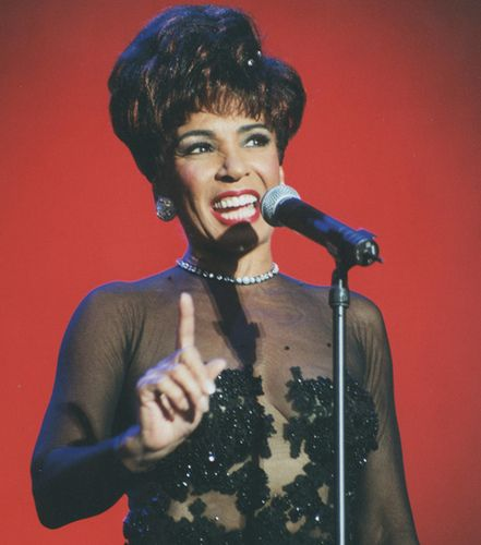 """Shirley Bassey - theatrical and powerfully voiced, this Welsh singer broke down color barriers in Britain in the sixties and followed with a long career. Best known for the James Bond theme song, """"Goldfinger."""""""