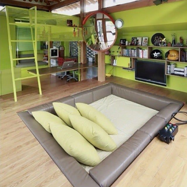 Pin for Later: These 19 Crazy Kids' Rooms Will Make You Want to Redecorate Immediately Bunker Style Ladders, video games, and an in-ground bed!
