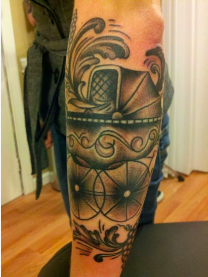 Baby carriage tattoo by chris hornus kevin royal tattoo for Can fbi agents have tattoos