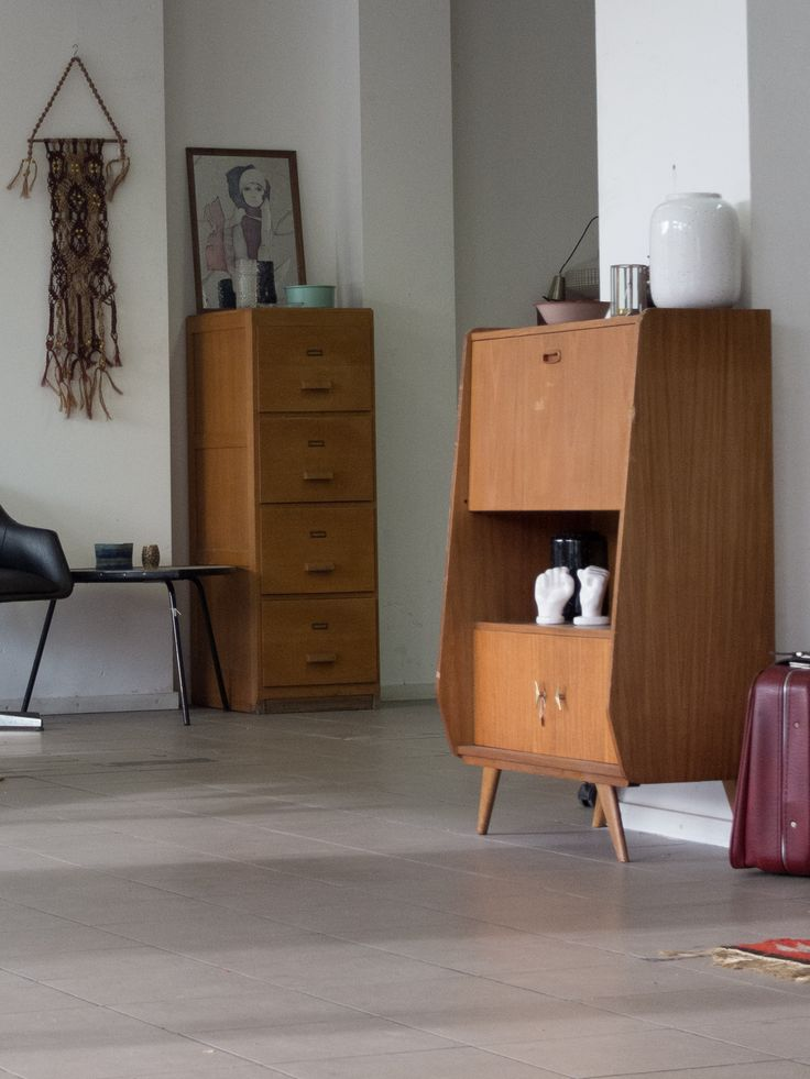 Front - Cabinet from Oslo. Back - Wooden filing cabinet.