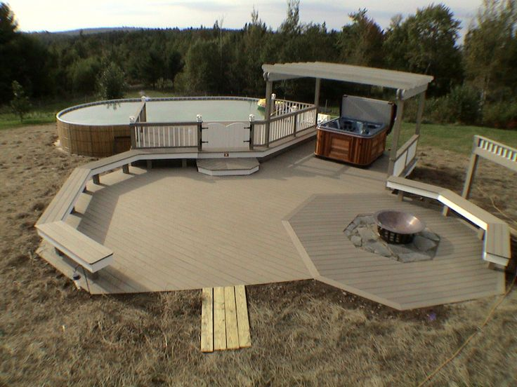 This custom outdoor living space was built in Maine by our Hickory Dickory Decks franchise Alvin Smith. Nice design.