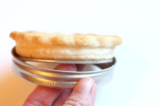 So Clever!  Make mini pies in 2 piece mason jar lids.  The flat lifts crust up and out for easy removal  -- like a 2 pc tart pan!   Shown is removing pie crust from mason jar lids