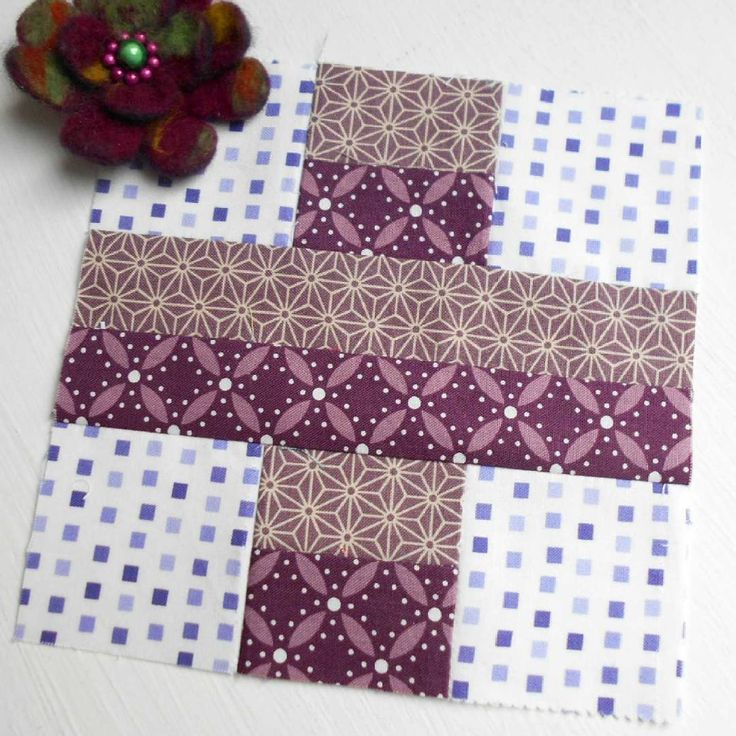 Block 140 - 100 Five. I wanted to make a purple block but only had these two purplish fabrics in my whole stash. Shopping time I think!