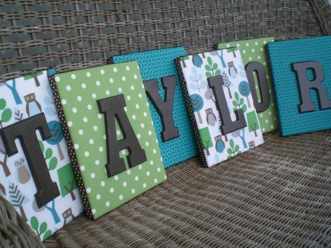 Fabric on canvas with letters in different colors.