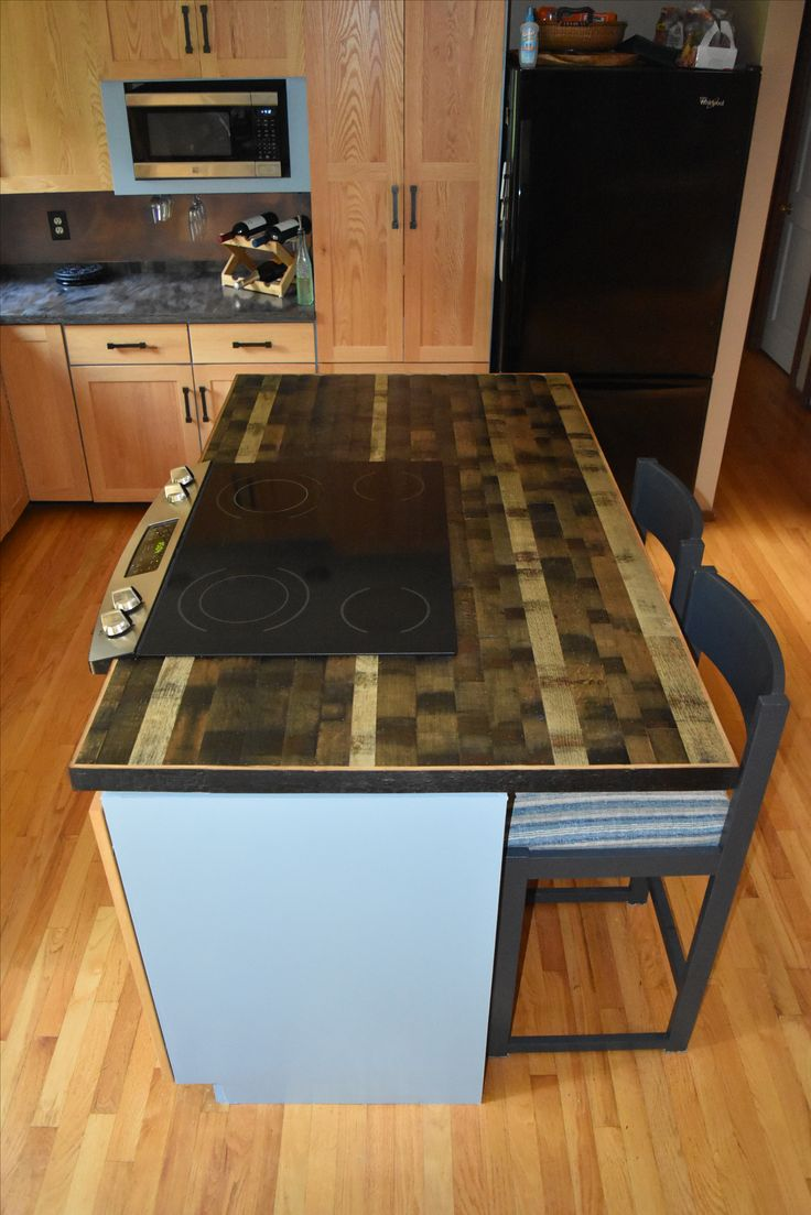 This Custom Island Counter Top Is Made From Our Blended Style Whiskey  Barrel Flooring. It