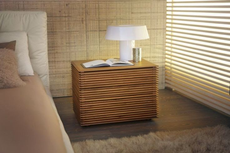 Wooden nightstand design with modern tones for beautiful master bedrooms | www.bocadolobo.com #bocadolobo #luxuryfurniture #exclusivedesign #interiodesign #designideas #bedroomideas #nightstandsideas #modernnightstands