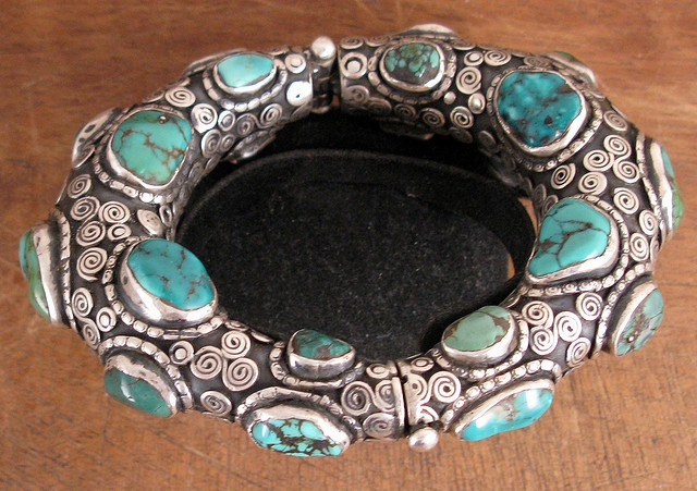 Nepal | Finely worked bracelet made from silver with Turquoise. Handcrafted in Nepal using traditional Tibetan designs.