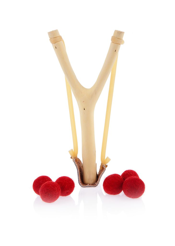 Get ready to fling some mischief with this handmade wooden slingshot. Expert craftsman sand down real forked tree branches, then lace them up with a leather pou