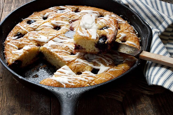 A quick, easy and delicious fresh sweet cherry kuchen, cooked up in a skillet and drizzled with a sweet, vanilla glaze. Great for any time of day!