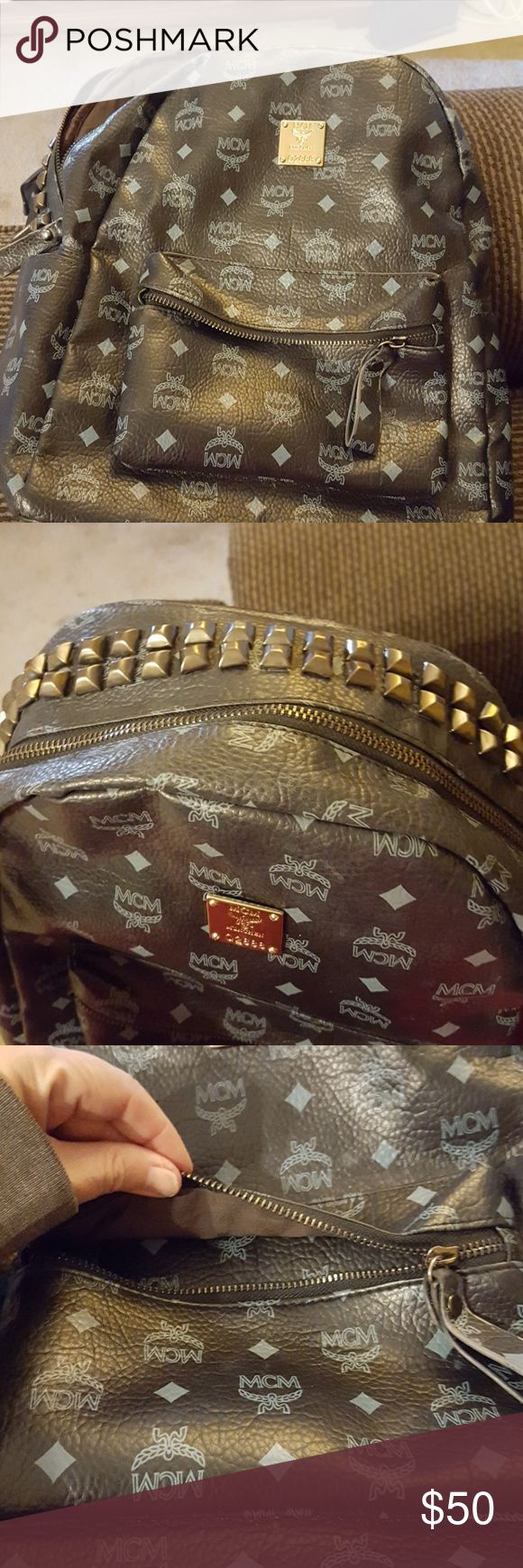 MCM Backpack Straps r torn. Beautiful backpack and classy with studs. Frugal price because of straps. MCM Bags Backpacks