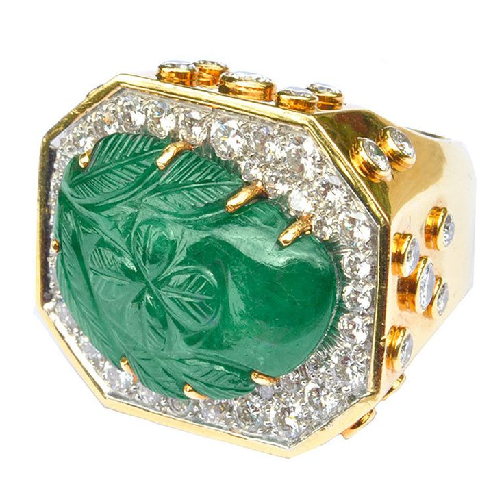 "DAVID WEBB .18 kt. gold and diamond ring, centering a large carved emerald in a ""paisley"" motif. Approx. diamond weight - 4.50 carats. Signed. USA circa 1980s"