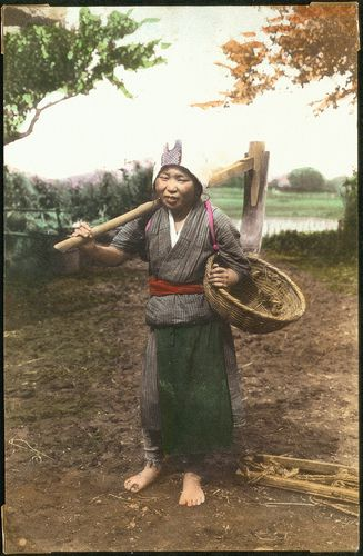 Woman with a tool over her shoulder and a basket under her arm, Japan.