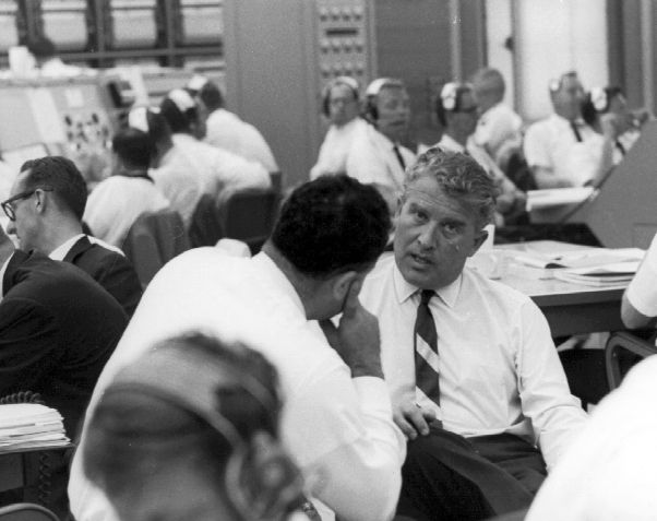 Dr. Von Braun appears to be in the launch control facilities at the Kennedy Space Center.