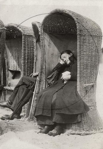 Old woman sleeping in a beach chair. Netherlands, 1917.