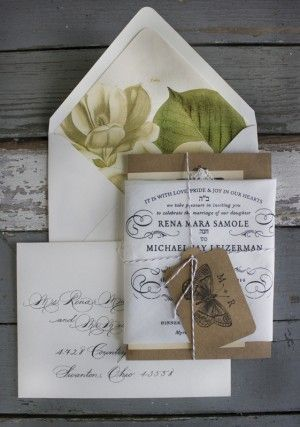 Created by the team at Lucky Luxe Couture Correspondence, Rena and Michael's invitation suite combines a classic black and white handkerchief invitation with a letterpress chipboard reception card and vintage rsvp postcard.  Just gorgeous!