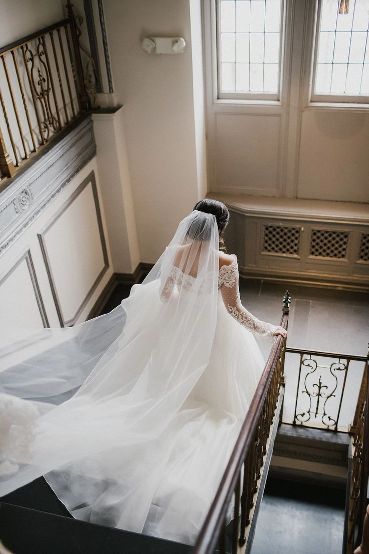 Tudor Arms Hotel real wedding, Cleveland | Bride wearing Legends Romona Keveza gown and lace jacket, Ivy and Aster sash, and Christos Bridal veil, all from Something White, A Bridal Boutique, Independence, Ohio | photo by The Carrs Photography