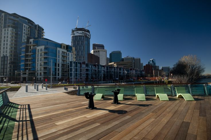 Located at the Calgary East Village RiverWalk. Exotic Hardwood Decking supplied by Kayu Canada Inc.
