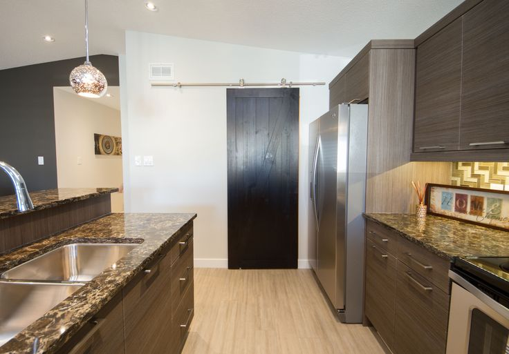 Cherrywood Showhome Kitchen with sliding pantry barn door