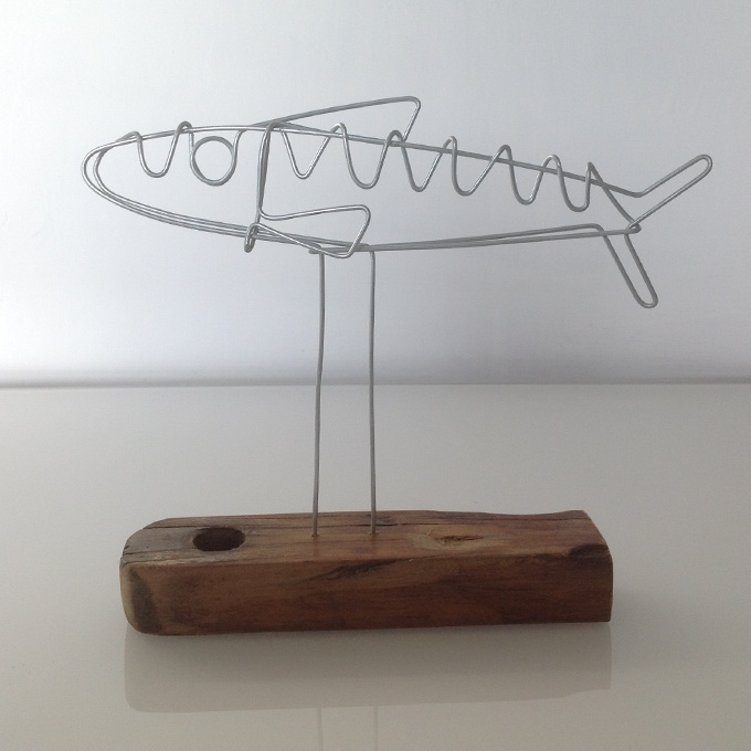 Wire mackerel doodle set into reclaimed deck chair timber
