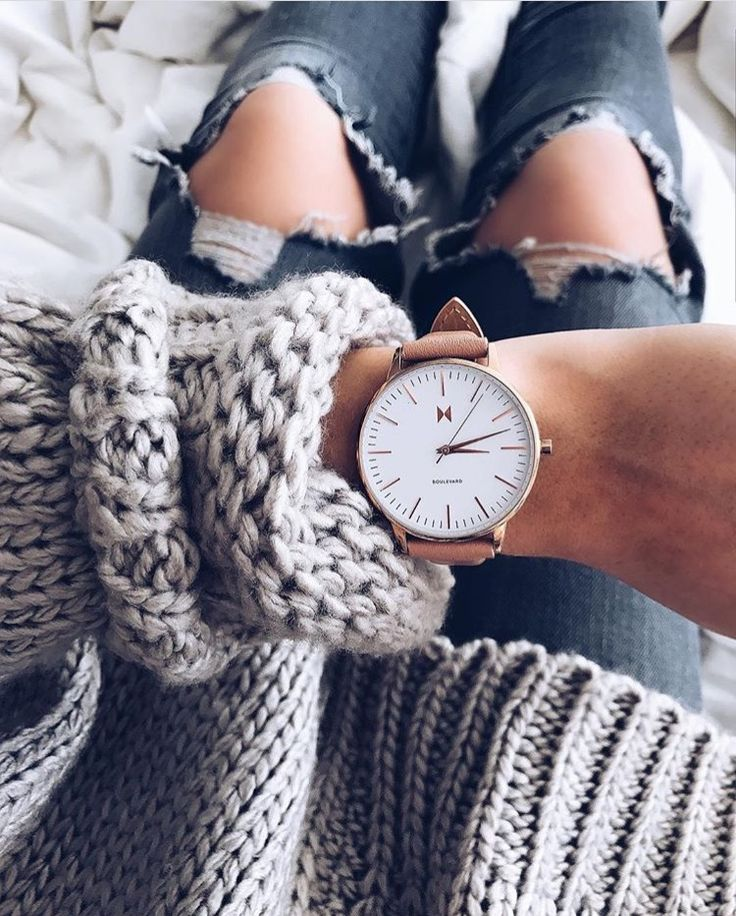 Blush Women's MVMT Watch, distressed jeans, and chunky sweater