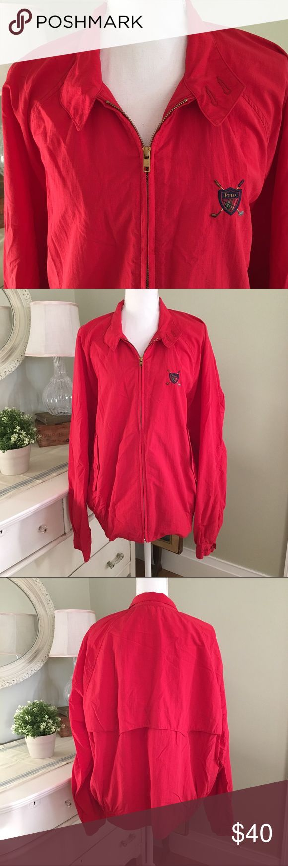 Polo by Ralph Lauren Red Windbreaker This rare red windbreaker from Polo by Ralph Lauren features adjustable cuffs, front buttoned pockets, stretch waistband and signature polo golf crest. Excellent condition! 100% nylon. Made in the USA. Size: Large. Polo by Ralph Lauren Jackets & Coats