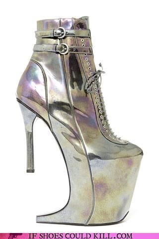 Shoe Designer: Olivier Theyskens for Nina Ricci    Silver spiked boots...although the heel doesn't even touch the ground due to the front wedge. Awesome.