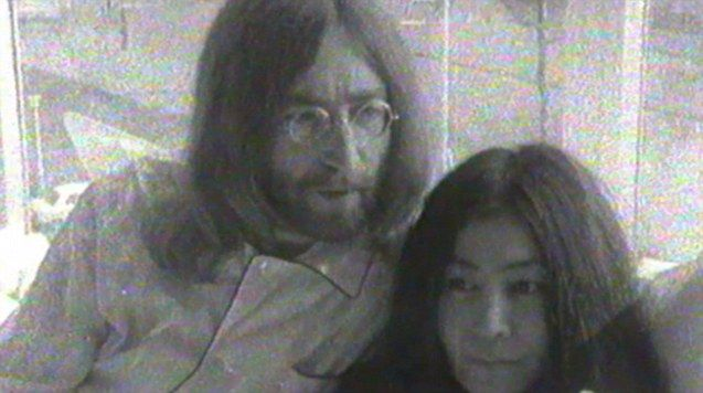 John Lennon and Yoko Ono promote peace together as part of their honeymoon in 1969 with bed-in.