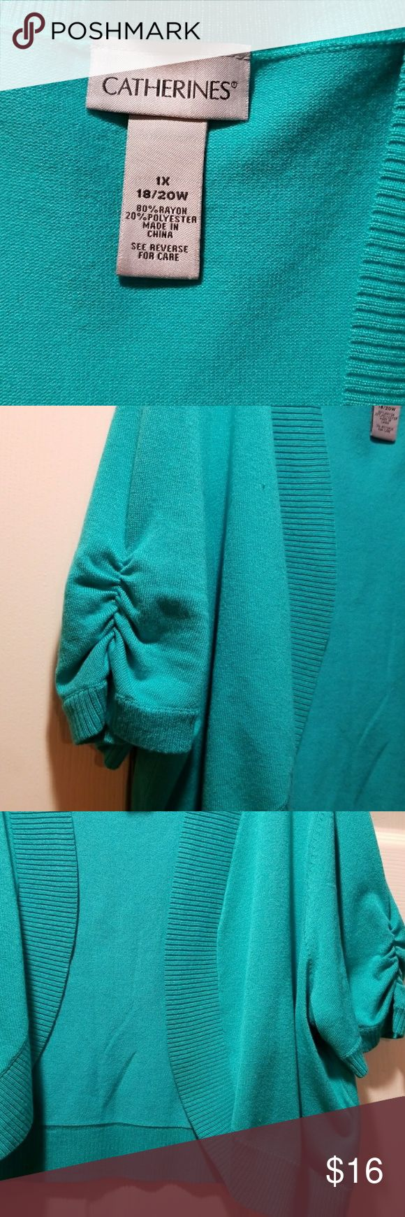 Catherine's  Shrug- Bolero,sweater Light teal color, 80% Rayon 20% polyester Elbow-length  sleeves. Has a pulled thread, as shone in pic. Dress not included. Catherines Sweaters Shrugs & Ponchos