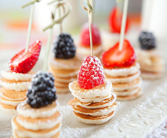 Pancake Coin Brochettes with Fresh Berries    These pancake mini stacks, garnished with fresh berries and powdered sugar, are ideal for a Mother's Day breakfast-in-bed or as delightful brunch hors d'oeuvres