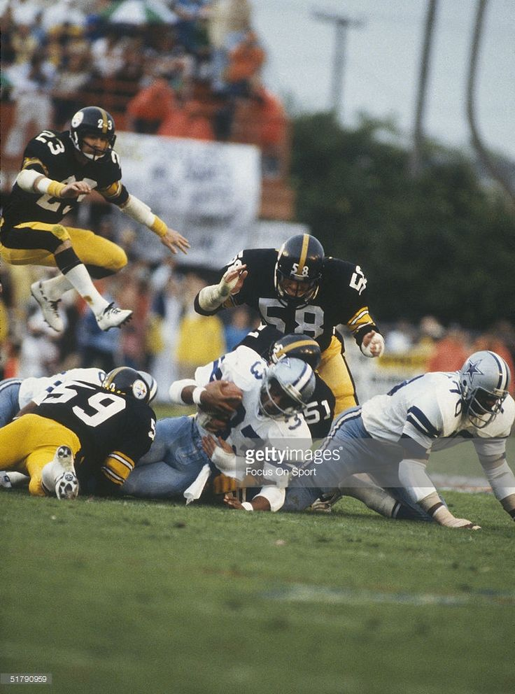 Dallas Cowboys running back Tony Dorsett #33 is tackled by the Pittsburgh Steelers' defense during Super Bowl XIII at the Orange Bowl on January 21, 1979 in Miami, Florida. The Steelers defeated the Cowboys 35-31.