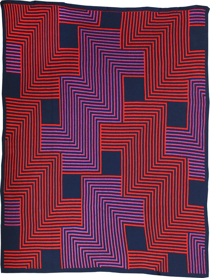 Red and purple blanket with graphic patterns and bold color palettes