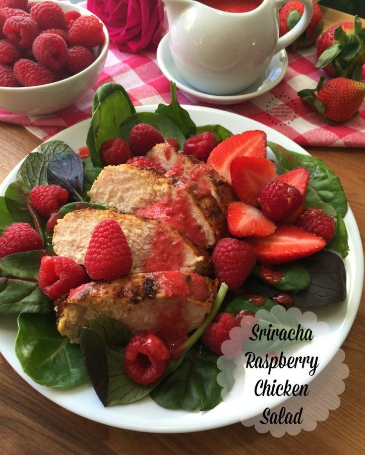 Lovely Sriracha Raspberry Chicken Salad, made with fresh greens, raspberries, grilled chicken and a homemade spicy raspberry dressing