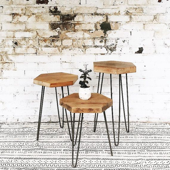 Perfect accent table for your living space or bed side. Mid-century modern hexagon side table made from true reclaimed wood paired with raw coated steel hairpin legs. Wood is lightly sanded and finished to preserve character. Wood top is approximately 15.5 x 13.75 Choose your height. Set of three includes one of each height: 18, 22, and 26. *Please allow a 1 variance on these dimensions to account for the unique nature of each piece of reclaimed wood.  This is a made to order item. You will…