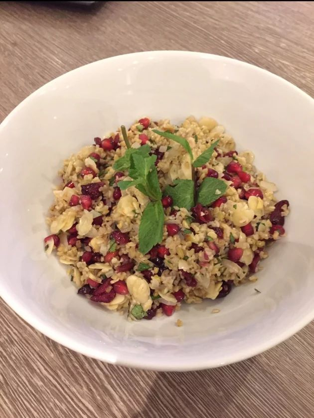 Freekah and Cranberry Salad  Freekeh is an alternative grain to quinoa and couscous, a combination of the both making a delicious texture.With pomegranate seeds and mint for a fresh tint