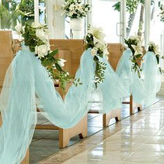 Smaller amounts of tulle would look nice either scrunched around each candle or snaked down the table in and out between the candle holders.