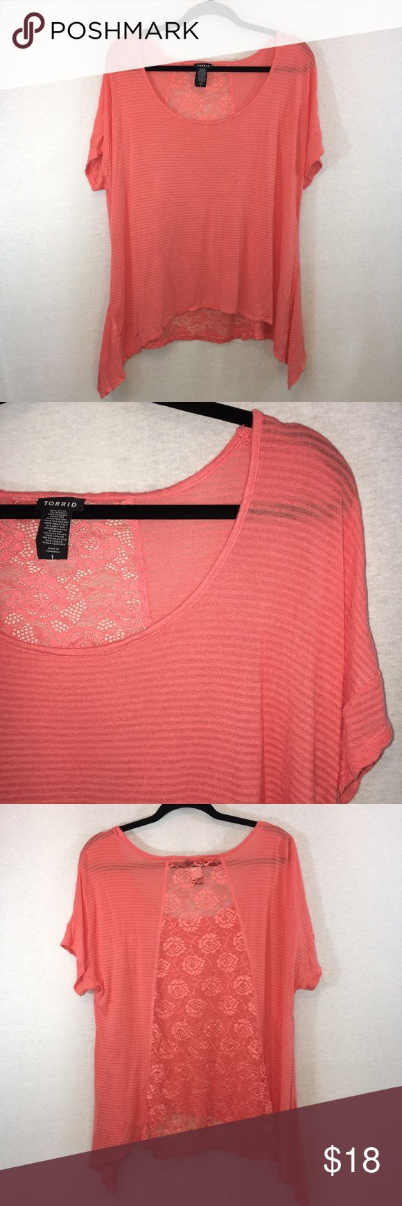 "Torrid salmon knit lace ribbed tunic sharkbite top Torrid salmon knit lace ribbed tunic shark bite top, size 1. Excellent condition. Stretch fabric measures approximately 24"" chest, 23"" front length, 31"" side length. Stretch fabric is 100% rayon. Lace is 93% nylon, 7% spandex. Smoke-free home. (A12) torrid Tops Tees - Short Sleeve"