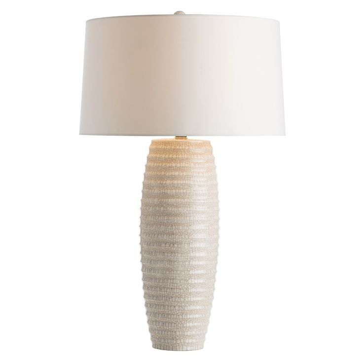 """The ivory crackle finish on this horizontally ribbed ceramic cylinder has been stained with a brown wash…the traditional Chinese method was to use tea. No matter the method, the result is a soft, warm, neutral coloration. The ivory microfiber drum shade maintains the monochromatic vibe as does the matching ceramic finial.  Material: Porcelain Finish: Antiqued Ivory Crackle  Shade: Ivory Microfiber Drum Shade Dimensions: 17""""W Top x 18""""W Bottom x 11""""H"""