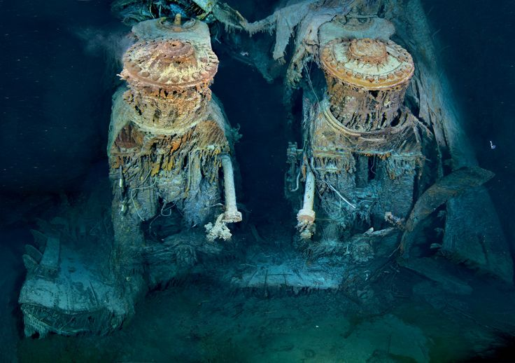 "Two of Titanic's engines lie exposed in a gaping cross section of the stern. Draped in ""rusticles""—orange stalactites created by iron-eating bacteria—these massive structures, four stories tall, once powered the largest moving man-made object on Earth."