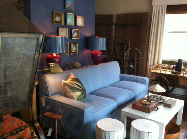 Gorgeous blue color in this sofa, and chic lamps!