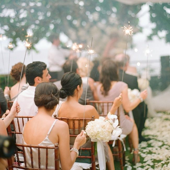 What a fun idea and different use for sparklers. This couple used them in the ceremony -- so fun! / photo: Elizabeth Messina