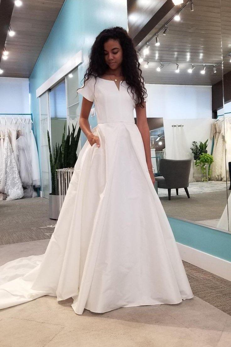 White Satin Short Sleeves Wedding Dresses With Pockets In 2021 Short Sleeve Wedding Dress Wedding Dress With Pockets Modest Wedding Dresses [ 1105 x 736 Pixel ]
