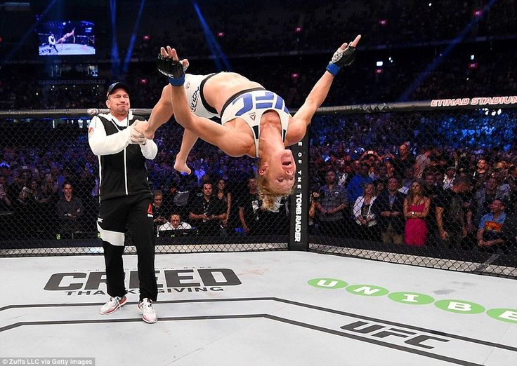 Holly Holm doing a backflip after knocking out Ronda Rousey.