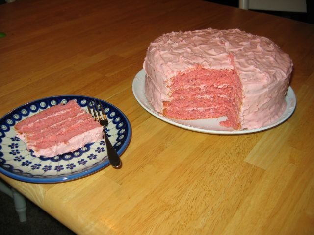 Nana's Strawberry Cake with Strawberry Frosting    1 White Cake Mix (Duncan Heinz Yellow works too)  1 C Mayonnaise  1/2 C Cold Water  1/4 C All Purpose Flour  3 oz box Strawberry Jello  1/2 of 10 oz Box Frozen Sweetened Strawberries - thawed  4 Eggs    Mix dry ingredients together then add the rest. Mix on medium speed for 2 min. or until completely mixed together. Pour into 2 oiled/floured round 9in metal cake pans & follow cake mix instructions for baking.I bake the cake at 350F for 34…