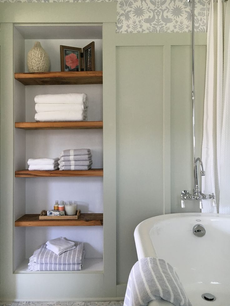 Recessed bathroom shelving with reclaimed wood. Stone