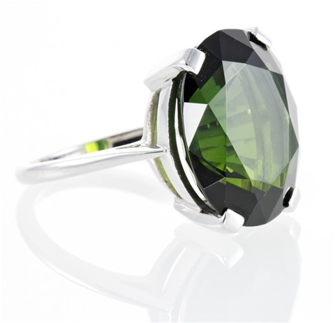 Dark green oval tourmaline ring... this is similar to the one we found and I fell in love with at Crystal Connection. I'm over the Opal thing I think.